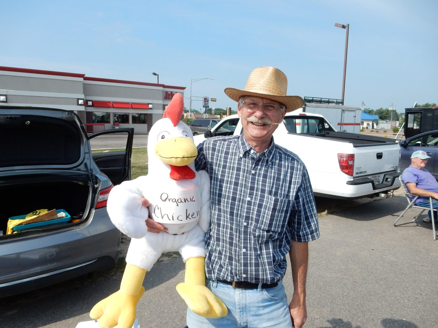 Jim Hartman poses while promoting his organic chicken. (Hub City Times Photo/ Adam Hocking).