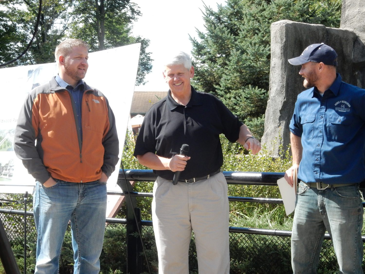 Mayor Chris Meyer, Parks and Rec Director Ed Englehart, and Zookeeper Steve Burns at the bear pen announcement.