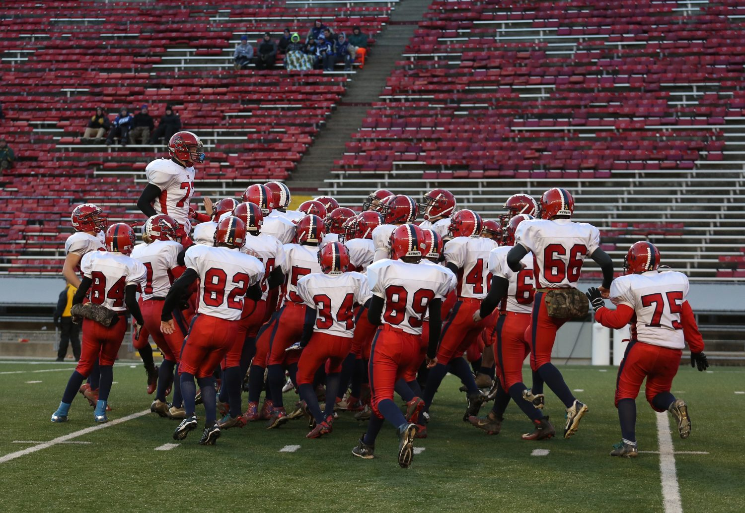 Spencer/Columbus' Dakota Andreae jumps above his teammates as the Rockets were introduced before losing to Amherst 42-0 in the WIAA Division 5 State Championship Game at Camp Randall Stadium in Madison, Thursday, Nov. 19, 2015.
