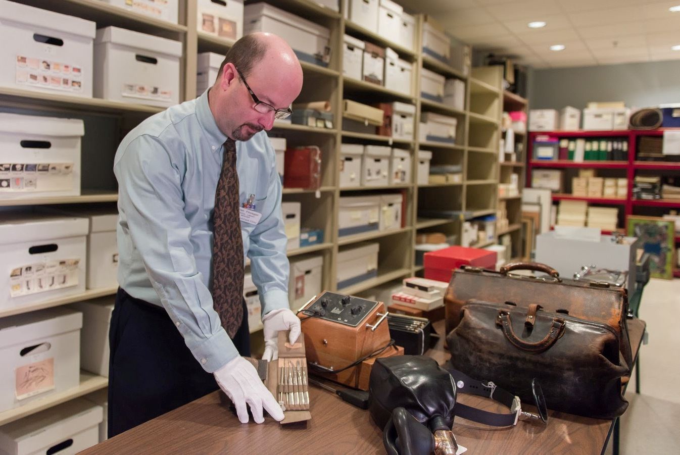 Brian Finnegan, manager of the George E. Magnin Medical Library and History Archive at Marshfield Clinic, displays medical equipment used in years past by clinic physicians.