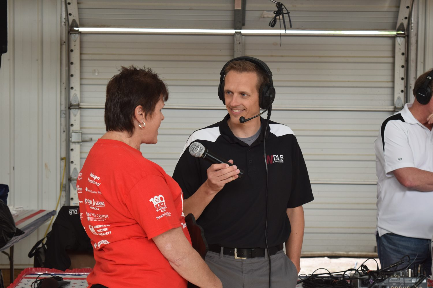 WDLB's Mike Warren conducts an interview during the festivities.