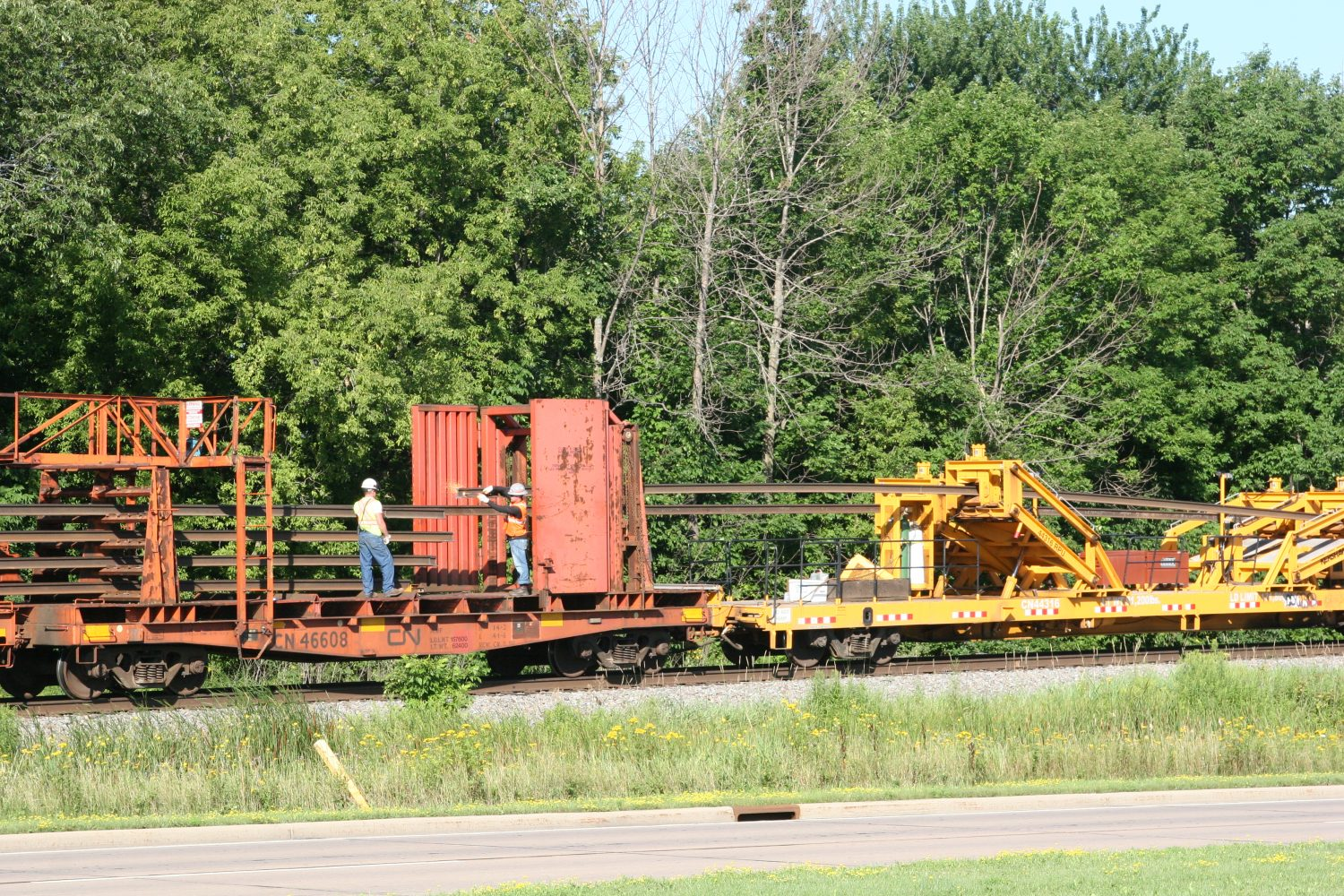 Canadian National crews load discarded rails just north of Marshfield Monday morning. The rails were remaining from the recent replacement of the track.