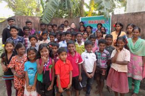 RaeAnn Thomas Gust (back row, center) surrounded by children from Eleanganny, India.