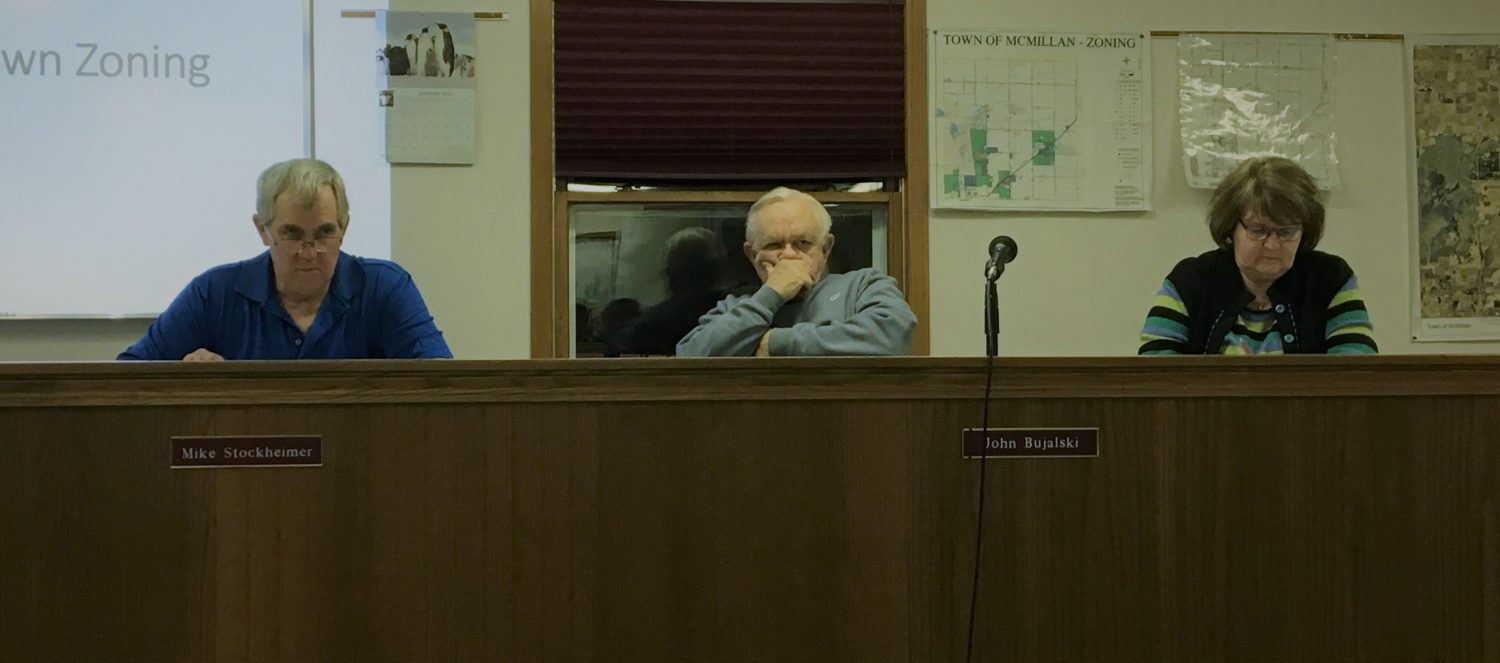 From left: McMillan Commissioner Mike Stockheimer, Chairman John Bujalski, and Commissioner Debbie Davis listen to public comments at the Feb. 6 meeting of the town of McMillan Planning Commission.