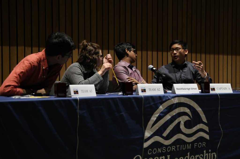 From left: Marshfield High School's Muhammad Abidi, Emma Raasch, Suhaas Bhat, and David Gui discuss an answer at the National Ocean Sciences Bowl national final on April 23.