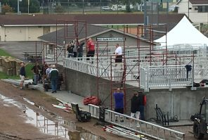 Crew raise the stage in preparation for this year's Central Wisconsin State Fair grandstand entertainment.